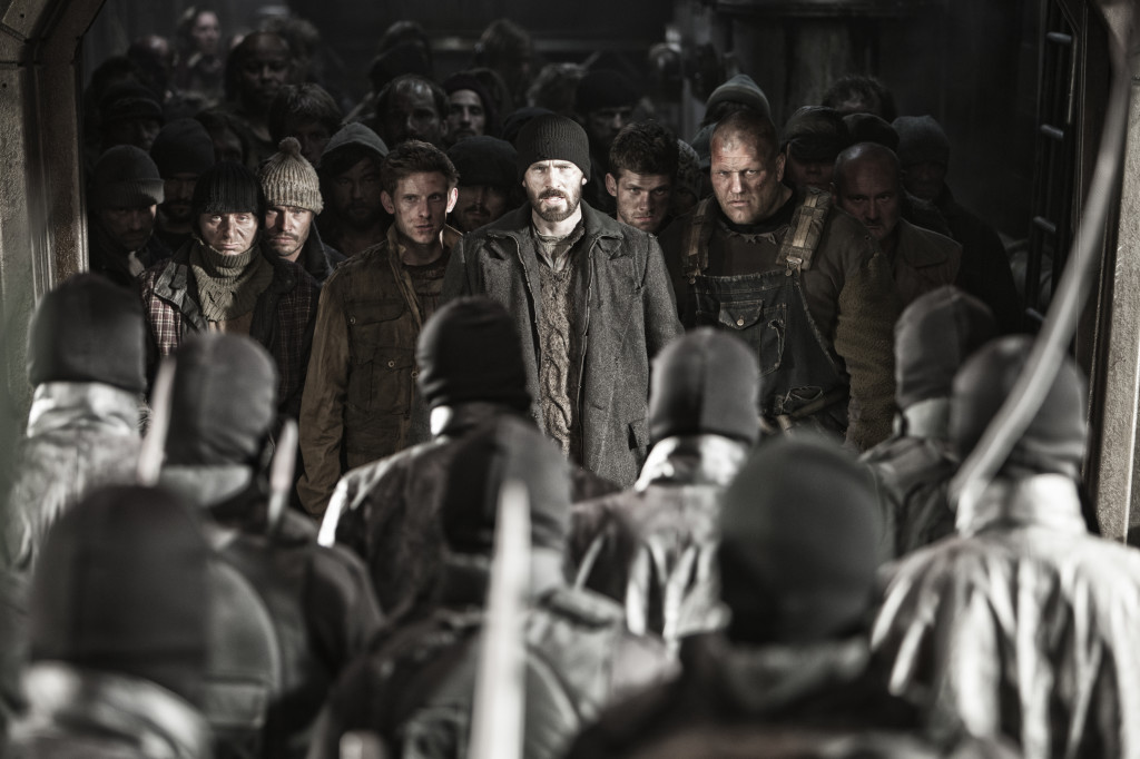 "Humanity struggles to stay warm in a train speeding around a frozen Earth in ""Snowpiercer"". (© 2013 - RADiUS/TWC)"