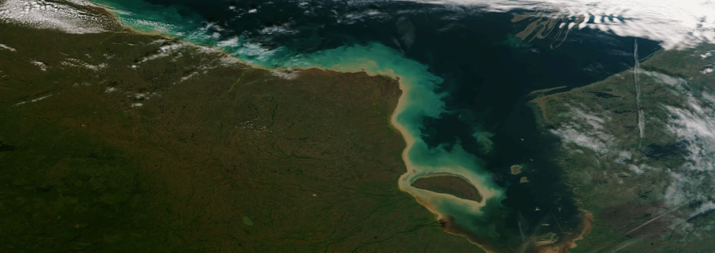 James Bay, the southern end of Hudson Bay in Canada, is shown here in an image taken by the Suomi NPP satellite's VIIRS instrument around 1825Z on September 17, 2013. Sediment flow from rivers and algal blooms can be seen well in this clear view. (NOAA/NASA)