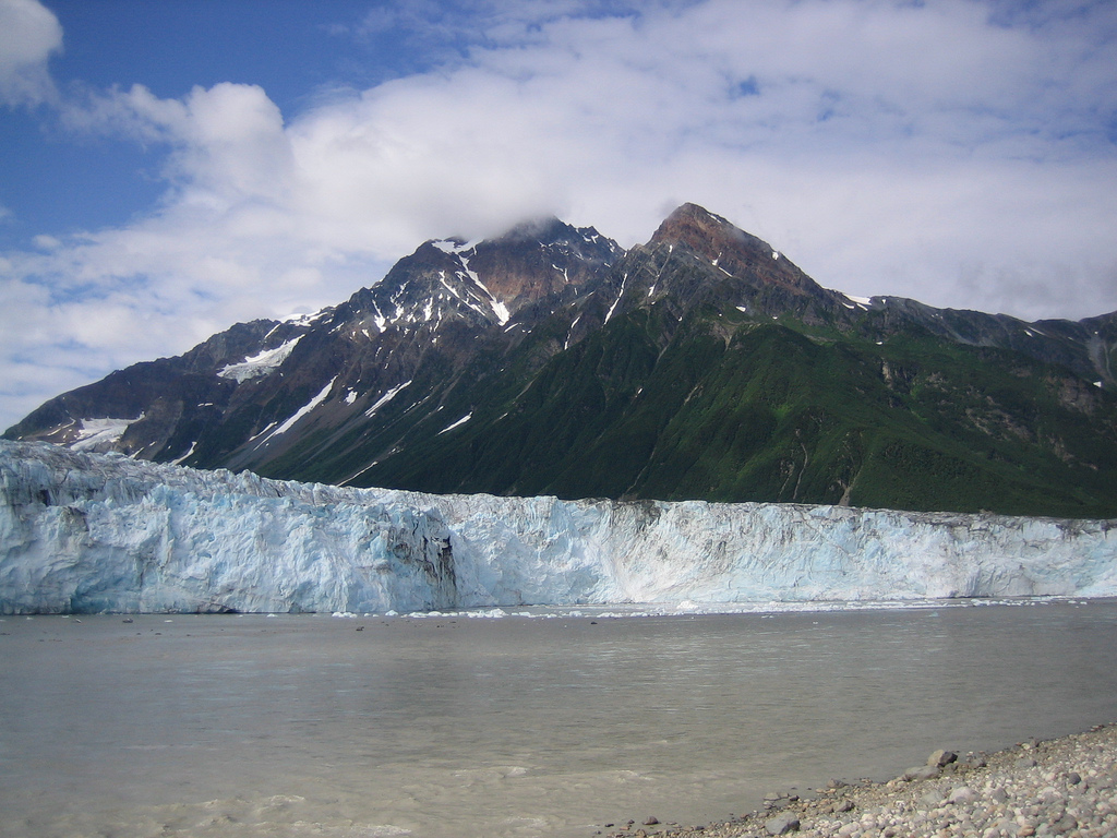 Ice breaking off into the Copper River from Alaska's Childs Glacier is said to make the ideal surfing wave, if you can get to it. (Rebecca/Flickr)