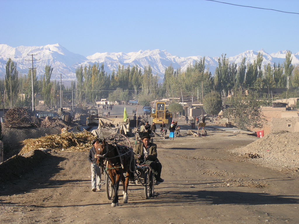 Uighur man walking along the Karakoram Highway in the early morning. (Matthew Winterburn/Flickr)