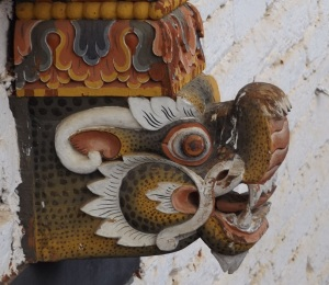 A carved head on pillar in the Punakha dzong. (photo: Ben Orlove)