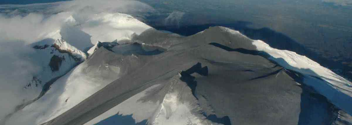 lack ash covered the summit of New Zealand's Mount Ruapehu after an eruption in 2007, but was soon covered by fresh snow. Long-term accumulation of black carbon aerosols in the Arctic and Himalaya is leading to increased melting of snow. (Photo: New Zealand GeoNet)