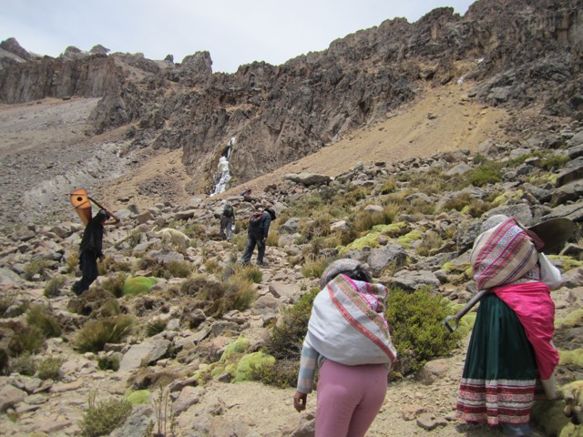 Peruvian villagers trek up Peru's Mount Hualca Hualca to make an offering to a mountain lord. (Photo: Astrid Stensrud)
