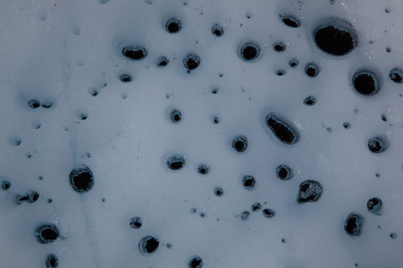Cryoconite holes (Source:  Joseph Dsilva)