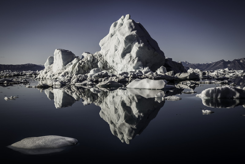 An iceberg from the Helheim Glacier in calm waters, Sermilik fjord, East Greenland. ©  Mads & Trine