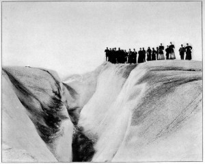 Tourists at the edge of a crevasse on Muir Glacier in Alaska, 1896. public domain.
