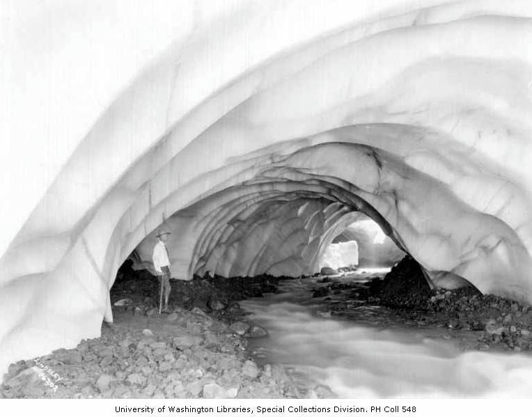 An image of a Hiker in Paradise Glacier ice cave on Mount Rainier, July 27, 1924