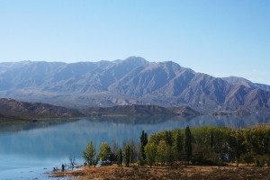 Clear waters of lake and Andes Mountains in Mendoza, Argentine