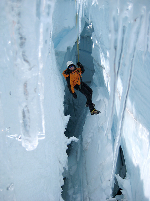 A glacier climber 'hanging' in a crevasse