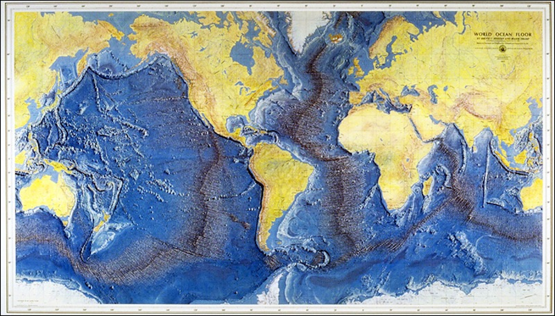 Map of the ocean floor. The mid-ocean ridges are shown as dark bands (Source: Earthguide).