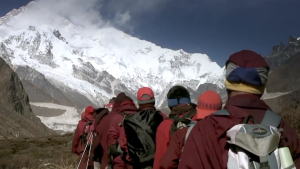 Followers of the Drupka wind their way through the perilous Himalayas. Source:  Screenshot of Pad Yatra Documentary
