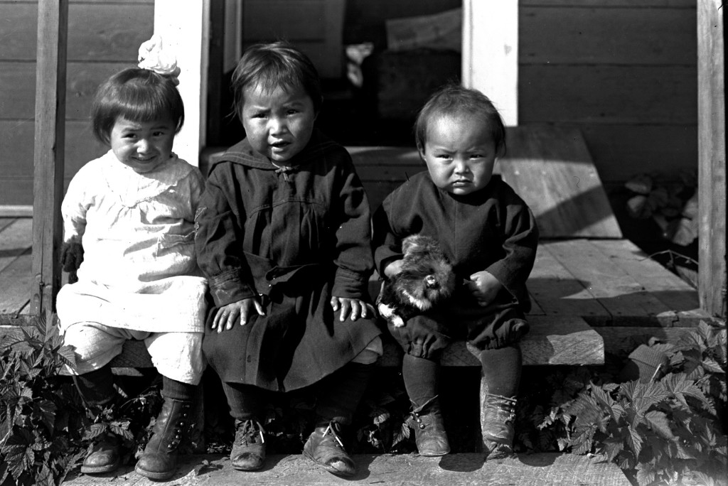 Unidentified children sitting on porch. Courtesy of Seiki Kayamori Photograph Collection, Sealaska Heritage Institute Archives, SHI-72-9
