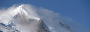image of wind blowing over the top of a glacier.