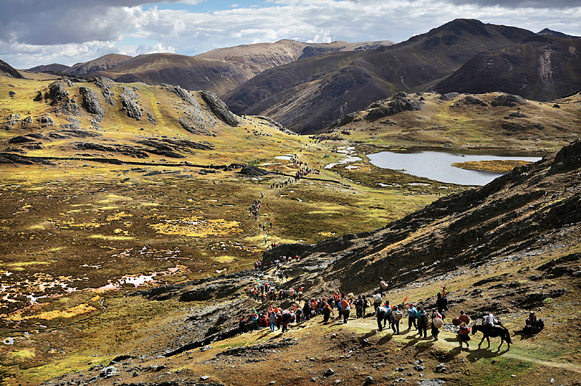 Image of pilgrims hiking to Quyllur Rit'I  in Peru.