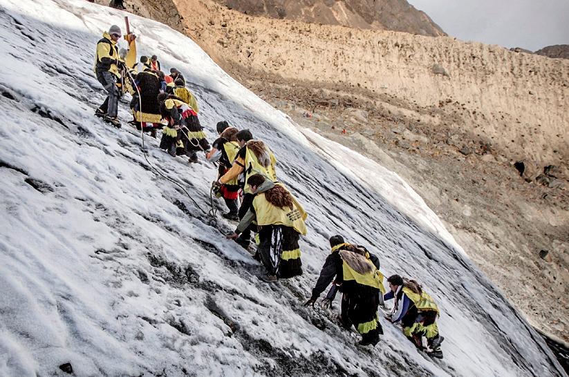 Ukuku hiking up the Qullqip'unqu glacier.