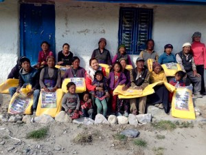 The people of Namgyal Village in Upper Mustang with donated tarpaulins in their hand