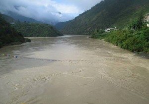Flooding on the Mochu River, courtesy of Kuensel via Facebook