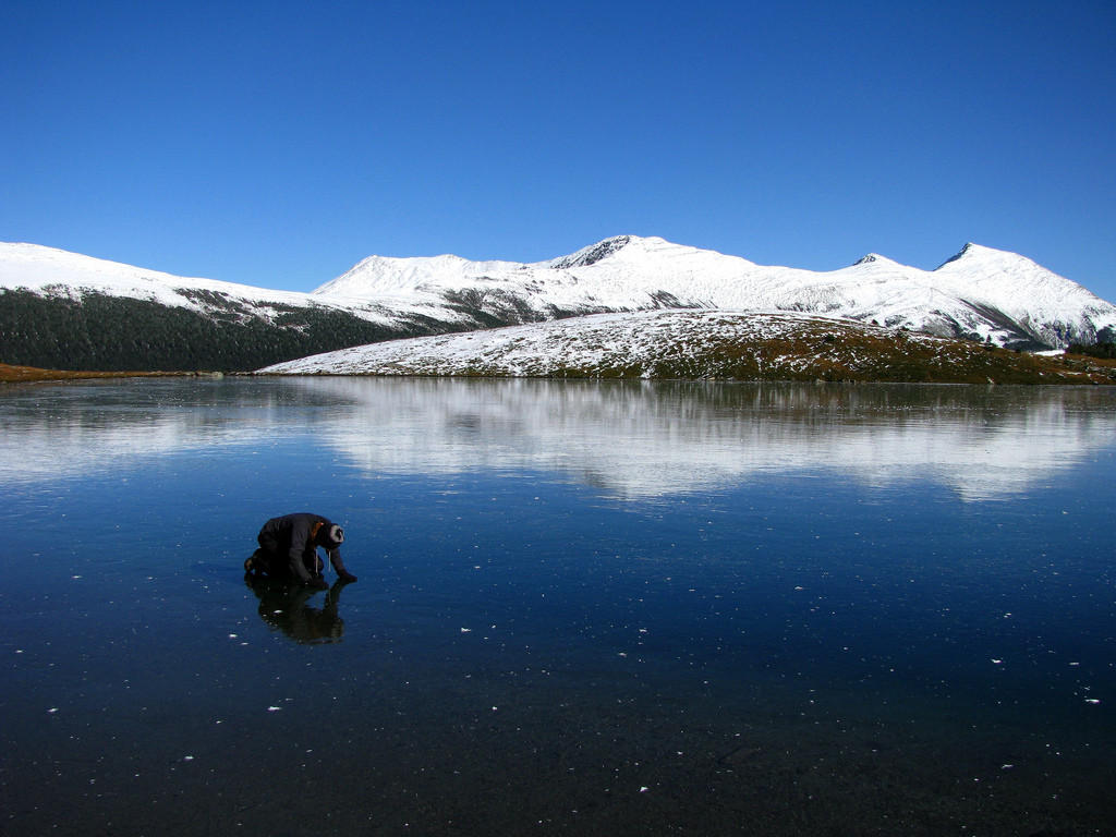An ice inspector in the Carriboo Mountains, British Columbia. Photo Credit: Dru! (via Flickr)