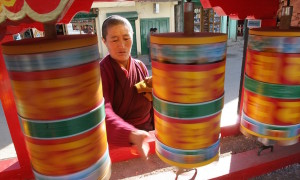 A Monpa monk spins prayer wheels at Tawang monastery