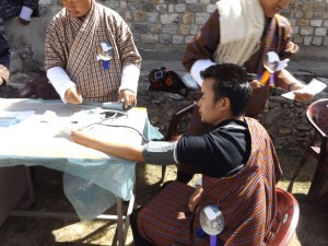 Visitor at festival having blood pressure checked by national health worker (source: Ben Orlove)