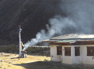 Burning incense as an offering in village below Jomolhari Temple source: Ben Orlove_