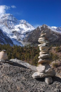 Prayer stones in front of Gangapurna glacier (Courtesy of :Vera & Jean-Christophe/Flikr, please contact the photographer before using)