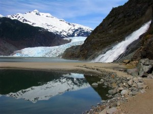 The mountain Stroller White is reflected in Mendenhall Lake on Friday, May 10, 2013, in Juneau, Alaska. Also pictured are the Mendenhall Glacier and Nugget Falls. (AP Photo/Becky Bohrer)