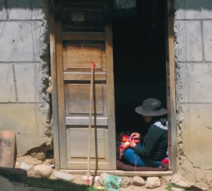 Woman embroidering in village near Huaytapallana source: UNU)