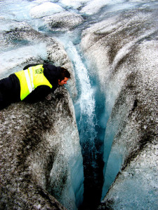 Water enters the depth of a crevasse on the Langjökull glacier, Iceland. Courtesy of Flickr user Ville Miettenin.