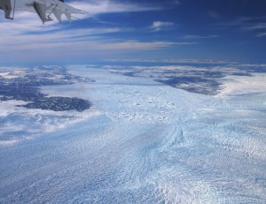 The surface of Jakobshavn Glacier in Greenland, is covered in crevasses, contributing to calving as the glacier meets the sea. Courtesy of William Colgan.