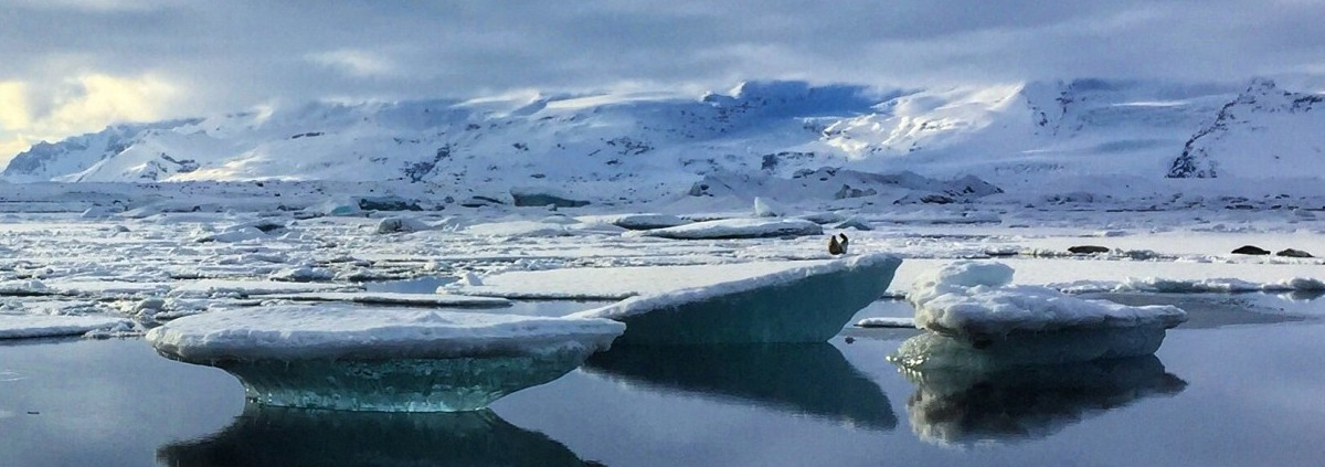 Tourists on Thin Ice in Glacial Lagoon