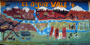 A mural protesting the destruction of water resources by mining. Courtesy of Flickr user Amilcar.