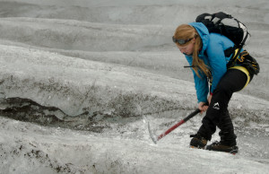 Tour guide using ice axe to make steps on glacier (source: Flcikt/Gregpoo)