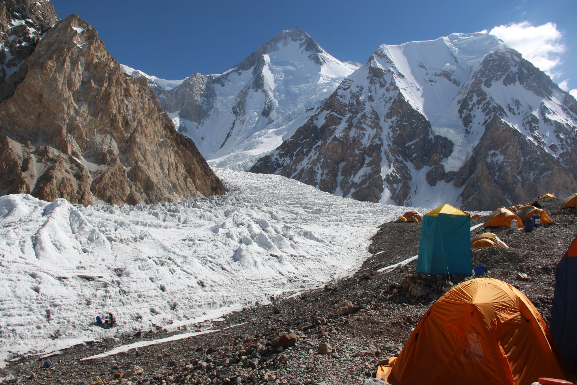 Temporary office (base camp) on Baltoro Glacier, Pakistan with Gasherbrum I in the background.