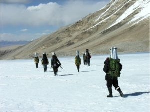 Researchers carry ice core samples for transport and storage.