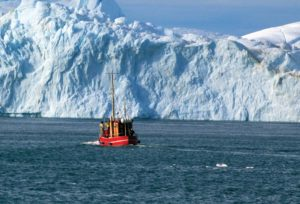 Boat in Ilulissat Icefjord (Greenland), Denmark. (source: UNESCO)