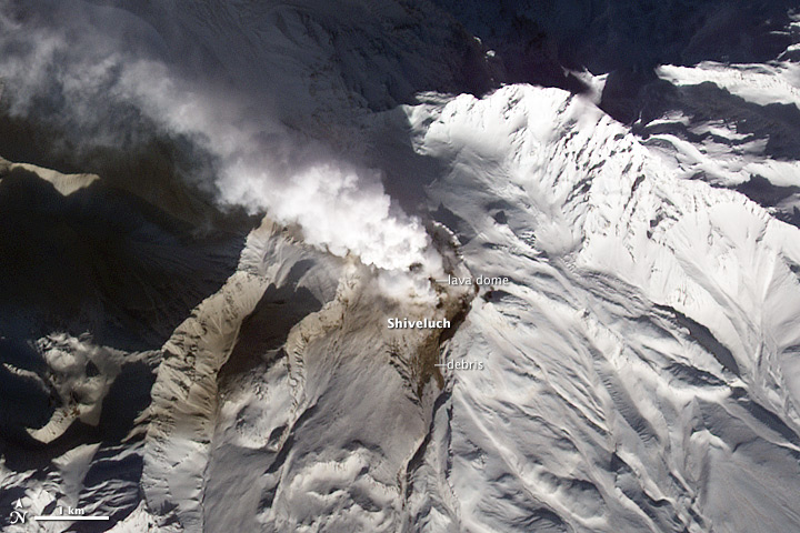 Ash plume over Shiveluch, one of the four volcanoes to erupt on january 1, 2013. (NASA)