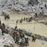 Engineers and labourers in Bhutan work to stabilise a glacial lake (Source: Dowchu Drukpa, DGM)