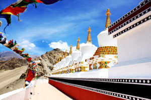 Photograph of the 9 stupas at Thiksey Gonpa (wiki)