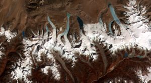 glacier lakes form from retreating glaciers in the Himalayas. Image provided by Jeffrey Kargel, USGS/NASA JPL/AGU