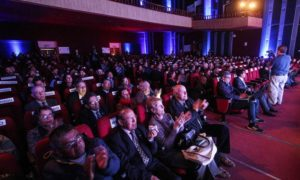 Audience and participants gather at the international climate change conference in Peru, which ran Aug. 10-12