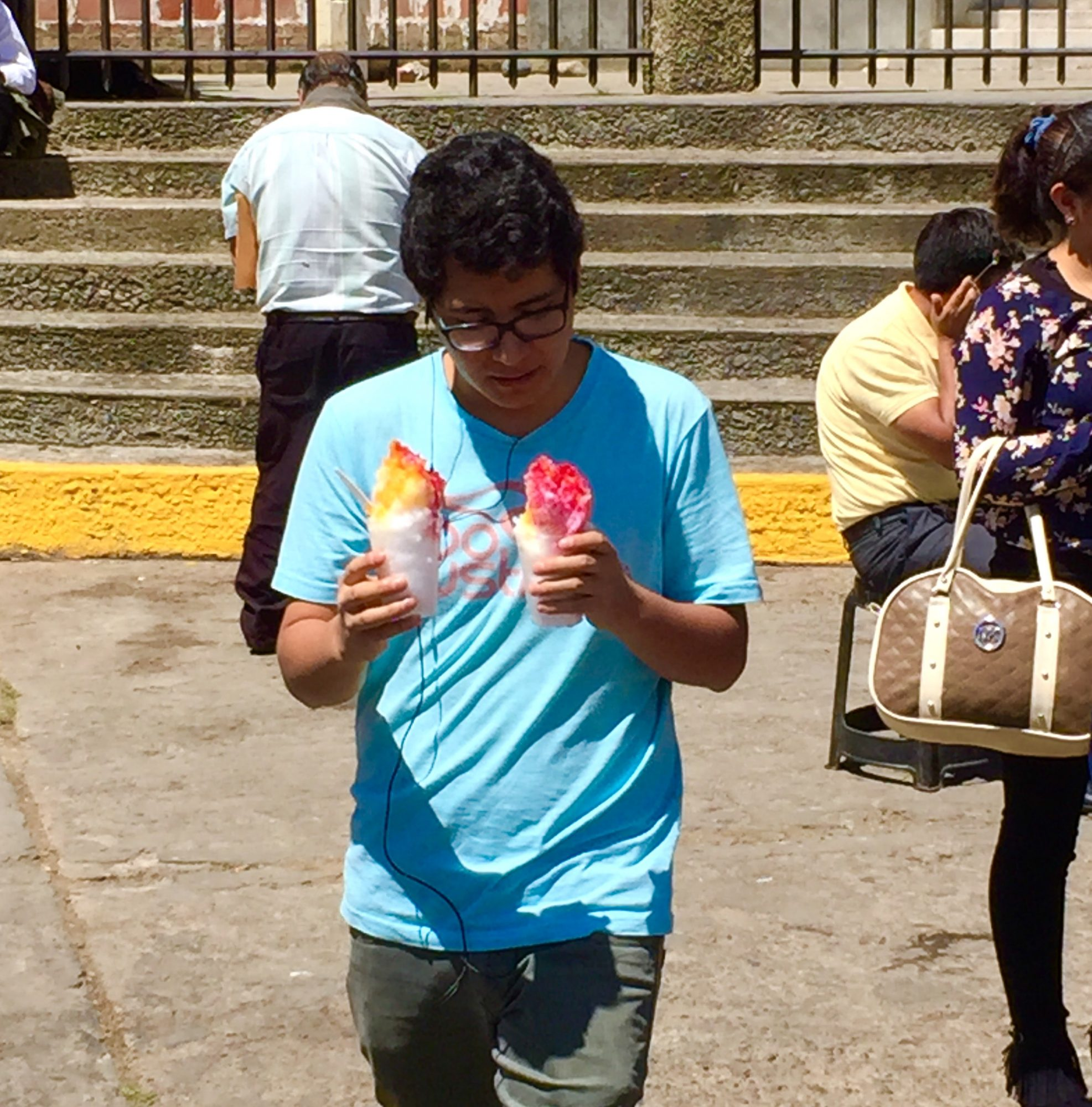 Man with two shaved ice cones