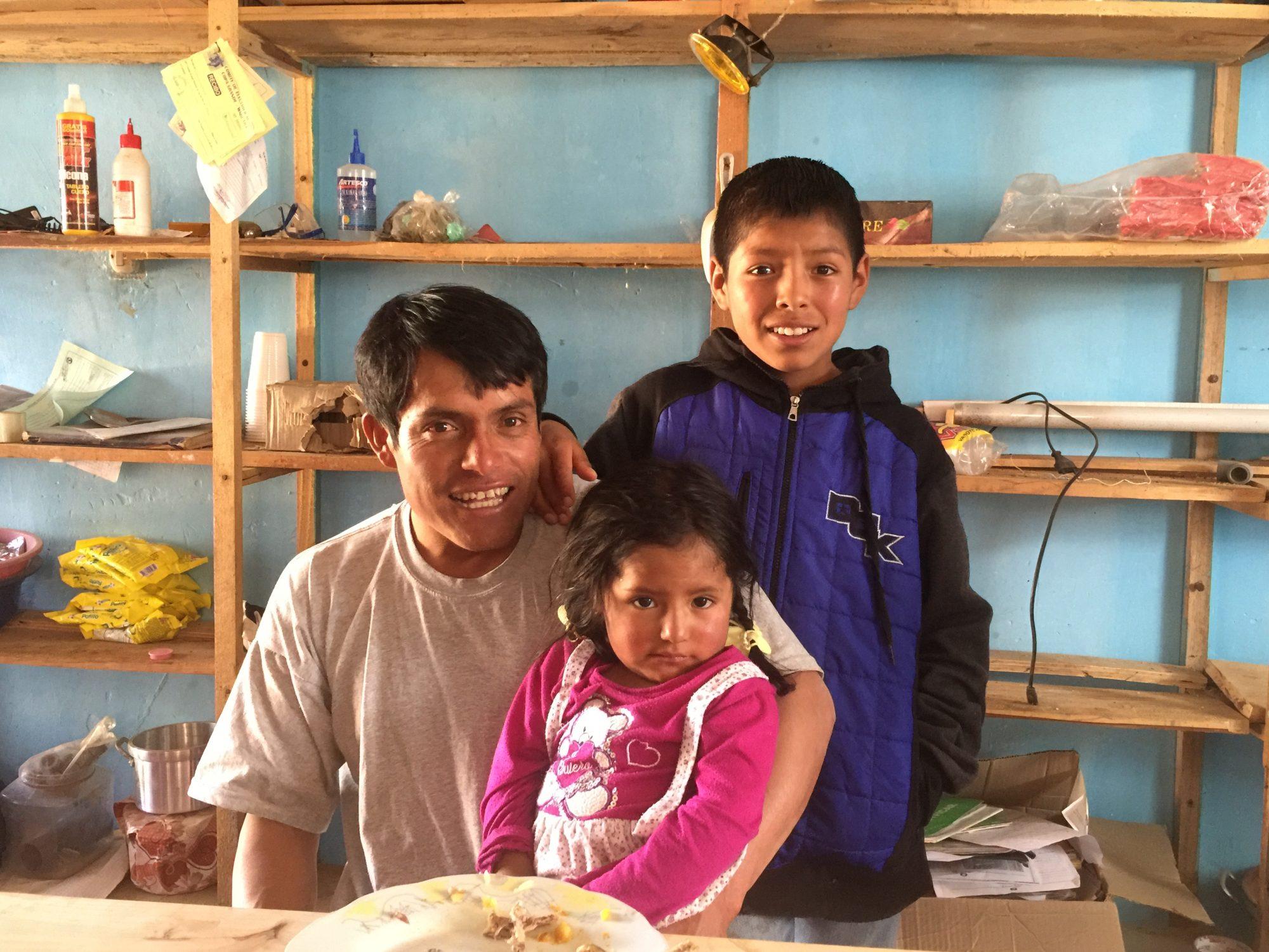 Shopkeeper and children in Copa Grande