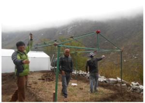 Langtang community members volunteering at the greenhouse construction. (Source: Chhime Tamang).