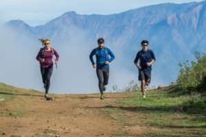 Three athletes running in the Andes Challenge (source: Facebook) https://scontent-iad3-1.xx.fbcdn.net/v/t1.0-9/14141539_1136067803116364_630030388729401205_n.jpg?oh=399a1b5fdfafc8321cc8014c62e0f2b2&oe=58378FEB