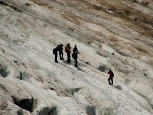 Scientists working on mountain glacier, photo credit: Oliver Grah
