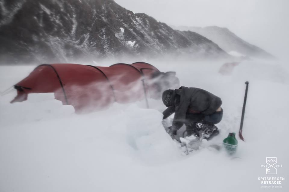 James attempting to recover equipment in a storm (Source: Liam Garrison/Spitsbergen Retraced)