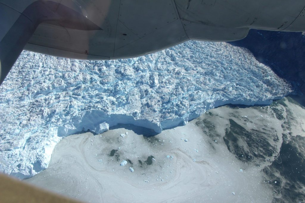 This image shows the calving of the Sermeq Kujatdleg glacier in Greenland