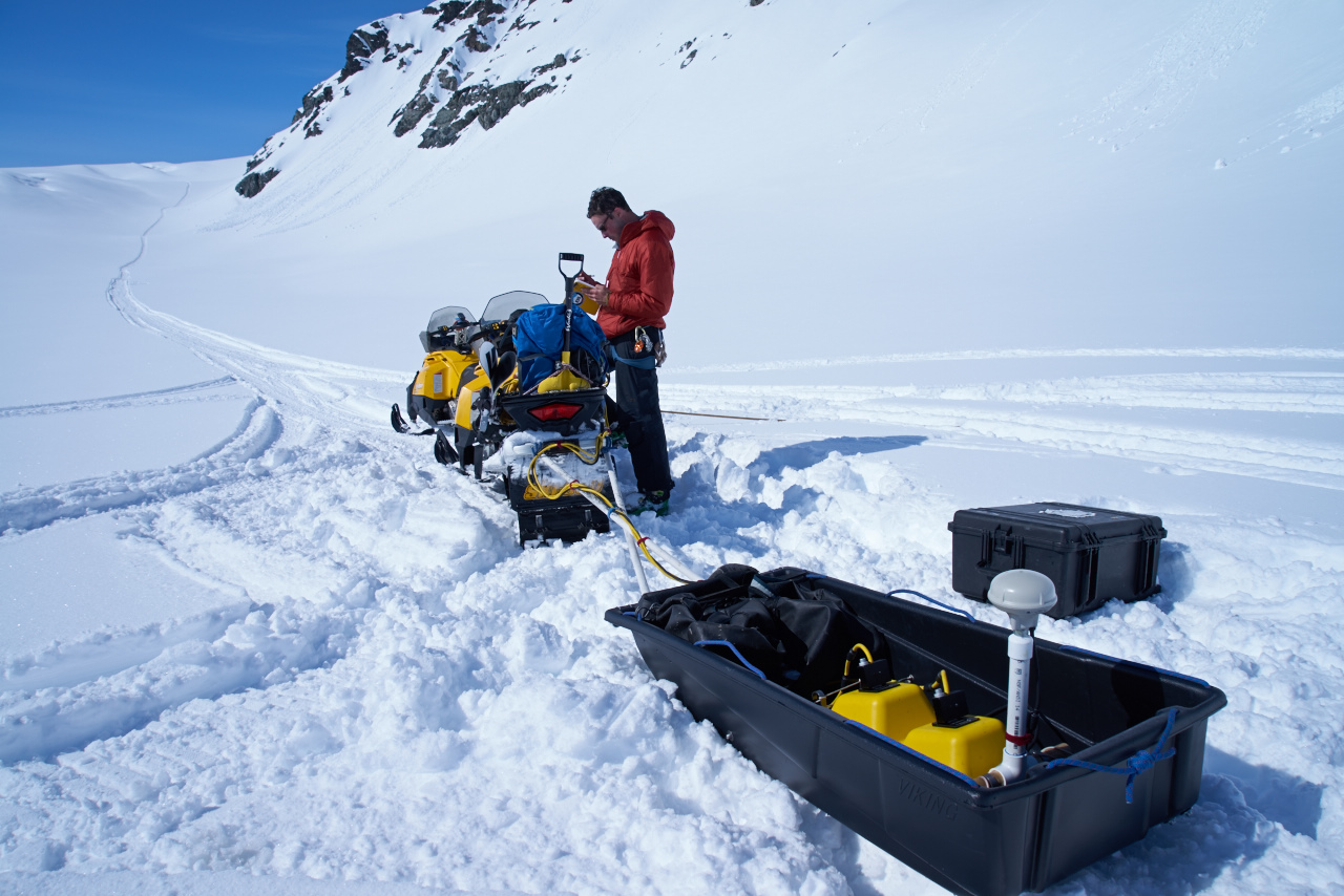 A researcher measuring the thickness of the snow at Gulkana glacier (Source: USGS)