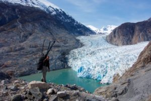 The explorers on the edge of an alpine glacial lake. Copyright Icelegacy